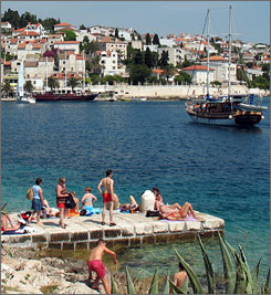 Tourist sunbathe in the port of Hvar, Croatia. Located east of Italy across the Adriatic Sea, Croatia expects over 200,000 American visitors this year, nearly double the number that arrived in 2005.