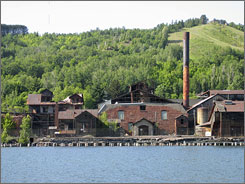 A former smelter is shown beside the Portage Canal near Hancock, Mich.