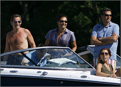 French President Nicolas Sarkozy heads out for a boat ride while vacationing on Lake Winnipesaukee in Wolfeboro, N.H. Wolfeboro has attracted famous visitors including Monaco's Prince Rainier and Princess Grace and author Kurt Vonnegut.