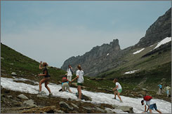 Snowballs in summer: A snowball fight breaks out on Highline Trail in Glacier National Park as the tour reaches high points where snow pockets survive into summer.