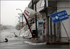 Debris lies at a flooded street after Hurricane Dean hits Chetumal in the Mexican state of Quintana Roo.
