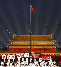 A year away: Flags fly and performers raise banners as China raises the excitement level with the one-year countdown celebrations in Tiananmen Square. The Games begin Aug. 8, 2008.