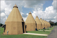 The Tee Pee Motel units line up along Highway 59 outside Wharton, Texas. The quirky bit of American history is one of four such lodges left in the country.
