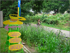 """Food and fun, awe-naturel: A biking path winds through Madison. The Badger State is big on biking; it's a national leader in """"rails-to-trails"""" conversions and offers more than 1,700 miles of trails."""