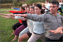 Participants take part in a yoga retreat at the Feathered Pipe center near Helena, Mont.