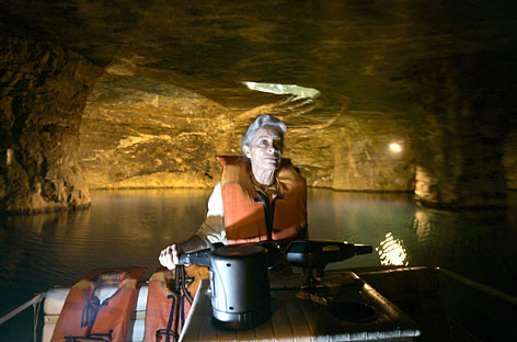 Donna Jones, manager at Bonne Terre Mine, gives a tour by boat of the now partially flooded underground attraction that has become a haven for scuba divers in Missouri.