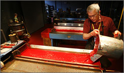 Charlie Doherty of Bethlehem, Pa., pours hot paraffin wax into a tray as he gives a demonstration of how crayons were made the old fashioned way in the early 1900's at The Crayola Factory, in Easton, Pa.