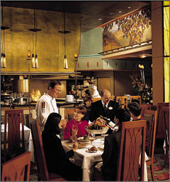 Visitors enjoy the dining room in the Napa Rose Restaurant at the Grand Californian Hotel, a Disney property.
