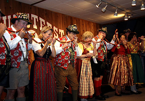 """The annual """"biting of the sausage"""" kicks off Wurstfest, an annual German festival held in New Braunfels, Texas."""