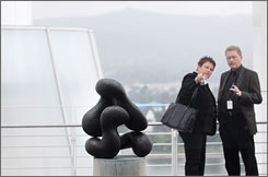 Visitors look at a sculpture by Hans Arp at the new Arp museum in Remagen, Germany.