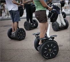 A group of tourists take in the sights of Washington aboard Segways. Advocates for the disabled are pushing Walt Disney World and SeaWorld Orlando to lift a ban on the use of the scooters.