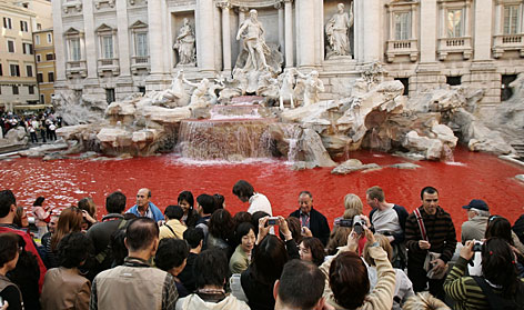 Rome's Trevi Fountain ran red on Friday following a vandalism attack in which a protester threw a bucket of red dye into the 18th-century landmark.