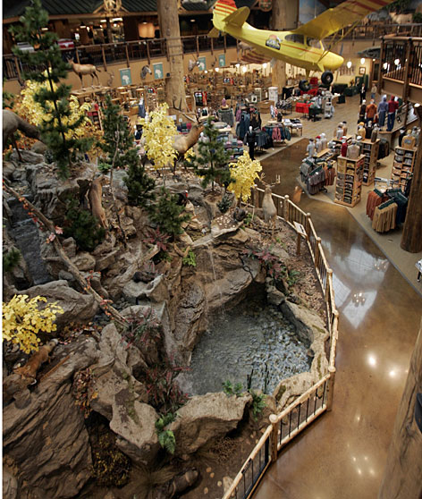 Customers are greeted as they enter the new Cabela's outdoors goods store in East Hartford, Conn., with the sight of an artificial mountain and a full-sized airplane.