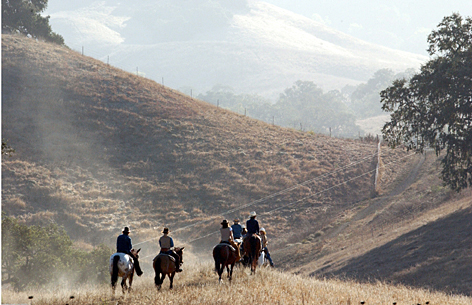 Taking the reins: Cowgirls-in-training ride across the 10,000-acre Alisal guest ranch in California wine country.