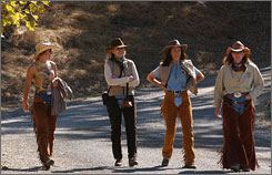 After an early morning ride, Cowgirls (left to right) Chris Bullock, Pam Oshay, Deborah Kaplan and Brenda Metzger walk toward  the lake for lunch at the 10,000 acre Alisal Guest Ranch and Resort in Solvang, Calif.