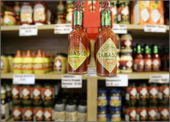 A variety of Tabasco sauce and products are shown at the Tabasco Country Store at Avery Island, La. The famous condiment now generates $250 million in annual revenue.