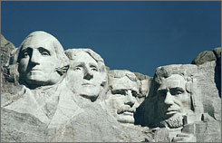 The Mount Rushmore Memorial in the Black Hills area of Keystone, S.D., pays homage to United States presidents, from left, George Washington, Thomas Jefferson, Theodore Roosevelt and Abraham Lincoln.