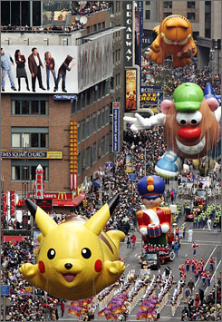 Pikachu leads a group of balloons down Broadway during the Macy's Thanksgiving Day parade in New York. The city provides a popular Thanksgiving getaway.