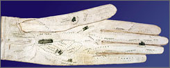In Field Museum's hands: This map-decorated glove depicting London, part of the Chicago exhibit, was created for the 1851 Great Exhibition.