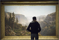 "A museum patron examines Thomas Hill's 1876 painting ""Yosemite Valley"" at the Yosemite Valley exhibit at the Nevada Museum of Art in Reno."