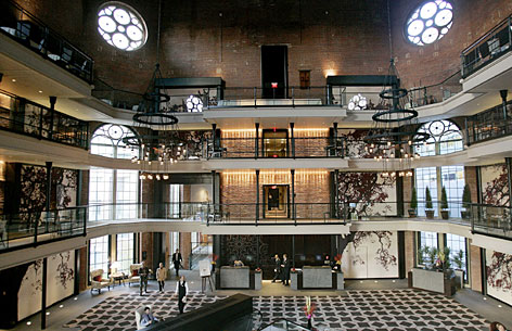Designers of the newly opened Liberty Hotel kept the prison guard catwalks as part of the hotel's lobby in Boston. The building, which was built as a jail between 1848 and 1851, was converted into a luxury hotel through a five year $150 million renovation project.
