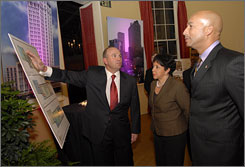 Developer Angelo Farrell and Sheila Johnson, founder of Salamander Hospitality, reveal plans to New Orleans Mayor Ray Nagin to restore the Cosmopolitan Hotel in the French Quarter in New Orleans.