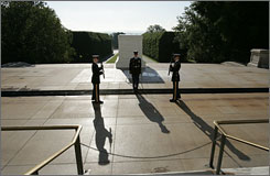 At Arlington: Sgt. Chris Moore changes the guard at the Tomb of the Unknowns, where soldiers from both world wars and Korea are buried.