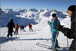 Skiers descend the 3,000 meter peak of Piz Nair in St. Moritz, Switzerland.