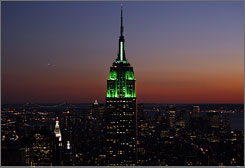 See the sights: The Empire State Building (illuminated) with green lights at sunset Oct. 12 in honor of the Muslim holiday of Eid al-Fitr) is a must-see spot for tourists.