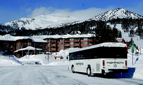 Green on white: A biodiesel-powered bus drops off guests at Eagle Lodge at Mammoth Mountain Ski Area in California. Mammoth Mountain urges visitors to park their cars and take advantage of the extensive bus network.