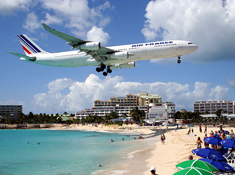 An Air France jet flys above Maho beach on the island of St. Martin in the northeast Caribbean.
