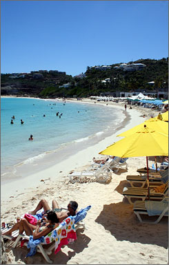 Visitors relax and swim on Oyster Beach on the island of St. Martin in the northeast Caribbean.
