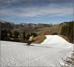 April Prout of Crested Butte, Colo., tries out the quality of manmade snow before Saturday's opening day at the Crested Butte Mountain Resort. Resort operators are hopeful that predictions for a Thanksgiving week snow storm are on the mark.