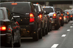 Automobiles wait in a traffic jam on a New York City highway on Tuesday. Americans are expected to travel in record numbers for the Thanksgiving holiday.