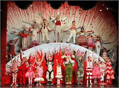 "A scene from a performance of  ""Dr. Seuss' How the Grinch Stole Christmas! The Musical."""