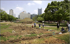 The Pittsburgh skyline is seen over Point State Park where archaeologists excavate the site around the original French Fort Duquesne in Pittsburgh.