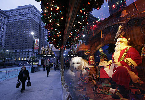 A potential shopper passes one of Macy's holiday window displays at its flagship store in New York's Herald Square. Manhattan's store windows have been transformed into winter wonderlands again and retailers hope they will put shoppers in a spending mood.