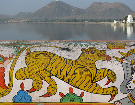 Icon under siege: The Bengal tiger, India's national symbol - depicted here in a mural in Udaipur, Rajasthan - is under threat from habitat pressure and an illegal demand for the animal's body parts.