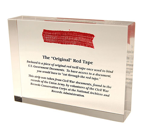 Sticky history: Red Tape Paperweight has a scrap used to bind Civil War documents.
