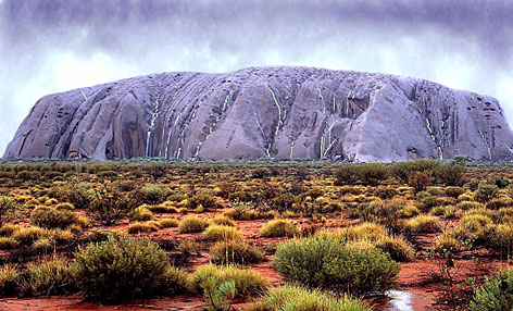 Ayers Rock (Uluru) takes on an unusual color as waterfalls cascade down its walls in central Australia. Starting in Jan. 2009, a global poll will allow people worldwide to vote and select the seven natural wonders of the world.