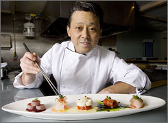 Presentation and taste, all in one: Sea Saw's chef and owner, Nobuo Fukuda, carefully assembles his dishes into works of art. 