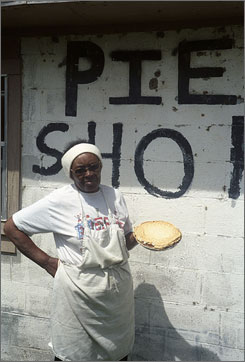 The pie queen: Mary Thomas, with one of her classic chocolate pies, runs the Family Pie Shop in De Valls Bluff, Ark.