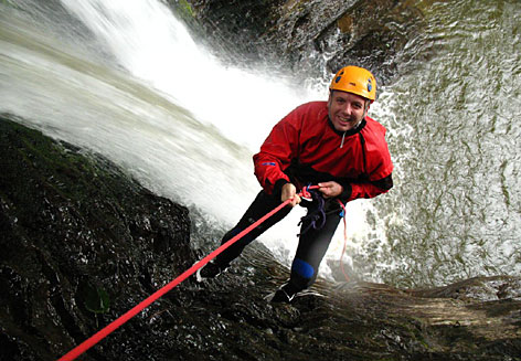 USA TODAY reporter Gene Sloan rappels down a narrow river canyon near Mont-Sainte-Anne in Quebec.