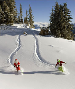 Winter sports enthusiasts don Santa Claus and Grinch costumes for a fresh powder run at Colorado's Crested Butte resort. Ski areas across North America are reporting better than usual conditions for this early in the season.
