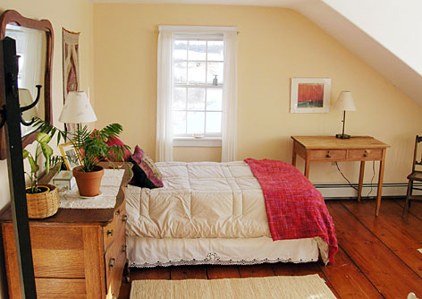 In Maine: Guests at Rolling Meadows can retreat to farmhouse bedrooms that feature restful colors, simple furniture, gorgeous views and wood plank floors.