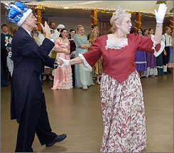 The newly crowned 2006 King and Queen Larry and Kathy Ferguson of St. Peters, Mo., greet the crowd at that year's King's Ball at the VFW Hall in Ste. Genevieve, Mo.