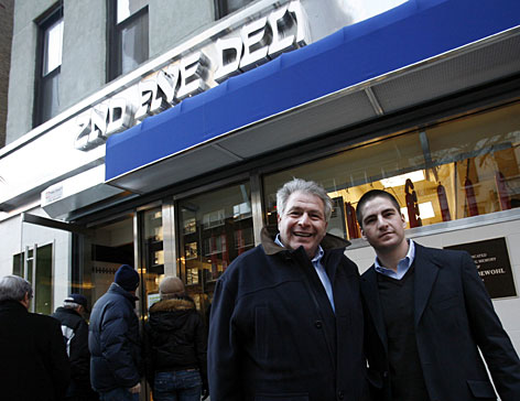 Jeremy Lebewohl, right, nephew of Second Avenue Deli founder Abe Lebewohl, poses with his father Jack Lebewohl outside the landmark deli in New York City. No longer located on Second Avenue but closer to Third Avenue, the reborn kosher delicatessen now survives while other legendary haunts have faded away.