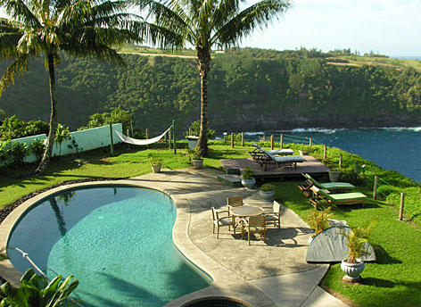 A deck view at a Bali bungalow at The Cliff's Edge, a B&B and Guest House in Huelo Point, Maui.
