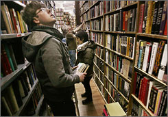 Customers peruse the goods at The Strand bookstore in New York City.
