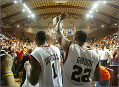 At Virginia Tech: Enthusiastic Hokie fans greet players as they enter Cassell Coliseum.
